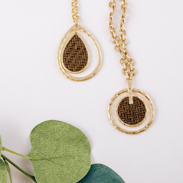 """Long cable chain necklace featuring a teardrop pendant with a raffia woven inspired center accent. Pendant approximately 2"""". Approximately 34"""" in length overall."""
