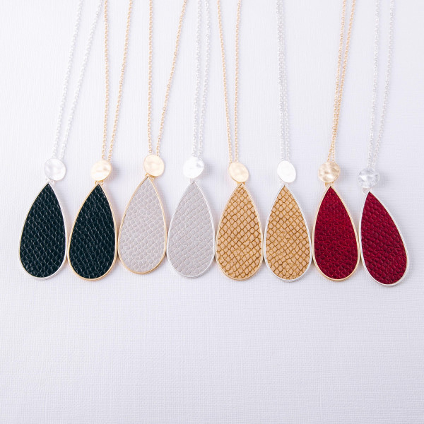 """Dainty gold cable chain necklace featuring a teardrop pendant with faux leather snakeskin details. Pendant approximately 3"""". Approximately 34"""" in length overall."""
