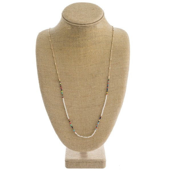 """Long dainty link bar seed beaded necklace with flower bead accents. Approximately 36"""" in length."""