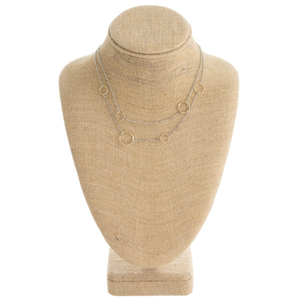 "Dainty layered necklace featuring circular accents. Approximately 16"" in length overall."