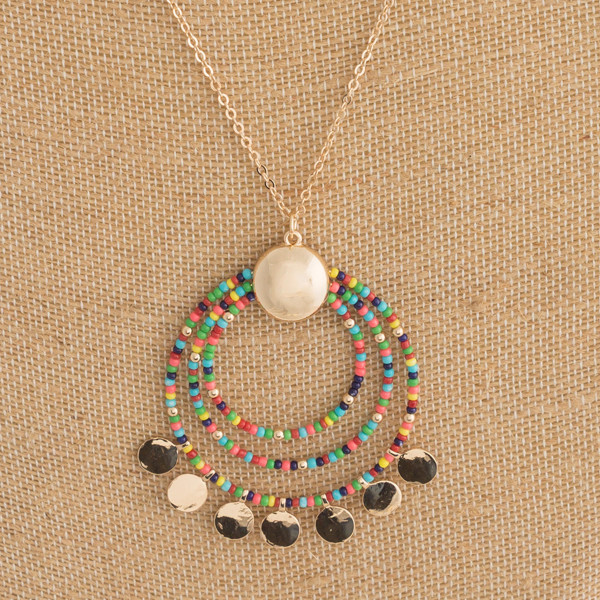 """Long dainty chain necklace featuring a seed beaded nested circle pendant with gold disc accents. Pendant approximately 2"""" in diameter. Approximately 38"""" in length overall."""