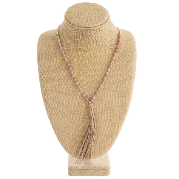 "Faux leather natural stone beaded tassel necklace with adjustable bolo closure. Approximately 38"" in length."