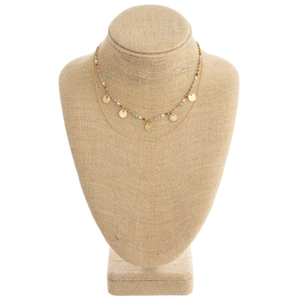 "Dainty layered seed beaded necklace with disc accents. Approximately 16"" in length."