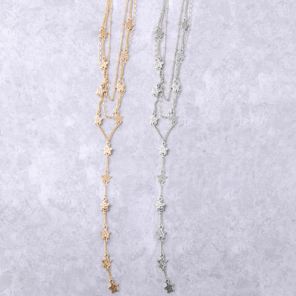 """Flat oval link, satellite and curb chain layered Y necklace featuring star accents. Approximately 30"""" in length."""