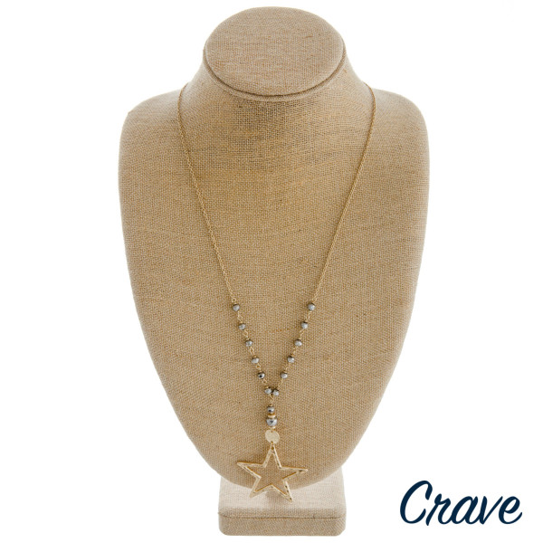 """Long cable chain necklace featuring a metal star pendant and faceted beaded details. Pendant approximately 2"""". Approximately 36"""" in length overall."""