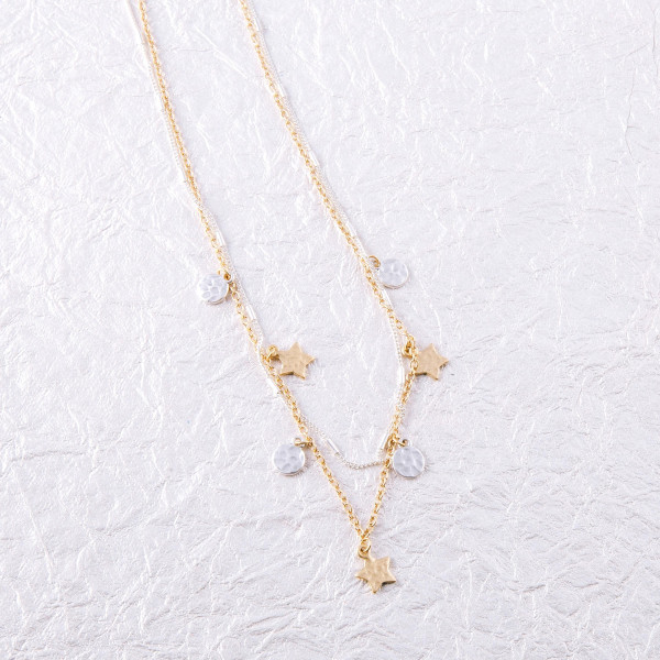 """Link bar and cable chain layered necklace featuring two tone star and disc accents. Approximately 18"""" in length."""
