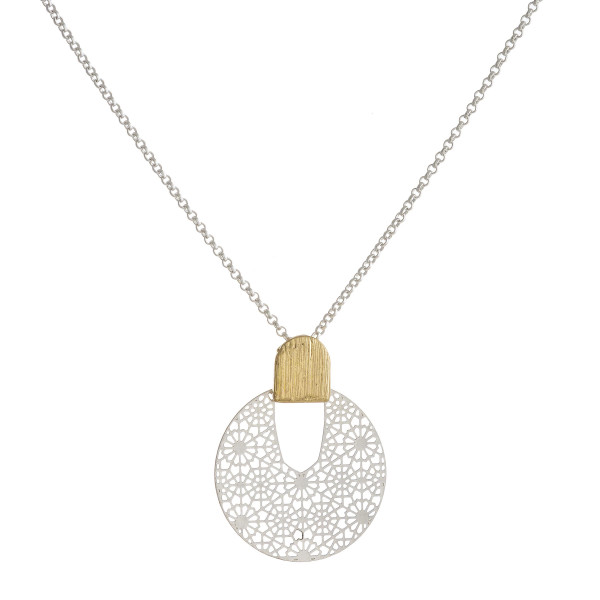 """Rolo chain necklace featuring a filigree disc pendant. Pendant approximately 1"""" in diameter. Approximately 18"""" in length overall."""