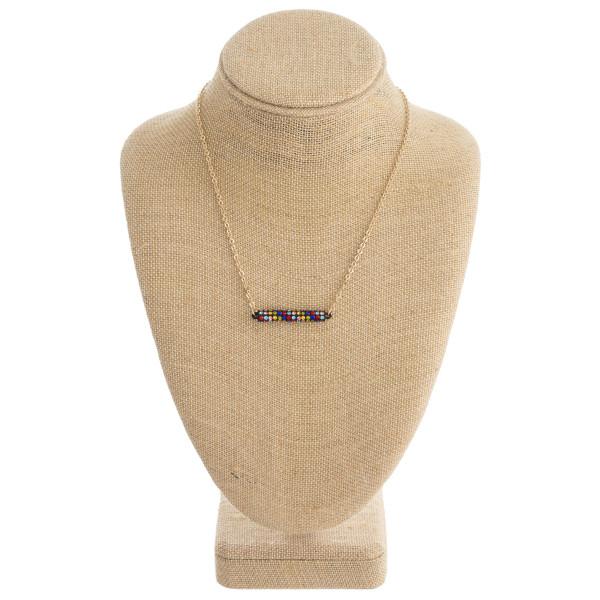 "Multicolor rhinestone round bar pendant necklace. Pendant approximately 1.5"" in length. Approximately 14"" in length overall."