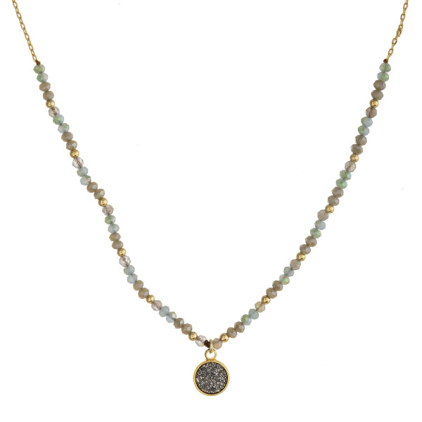 "Dainty cable chain necklace featuring faceted beaded details with a druzy disc pendant. Pendant approximately 1cm in diameter. Approximately 16"" in length overall."