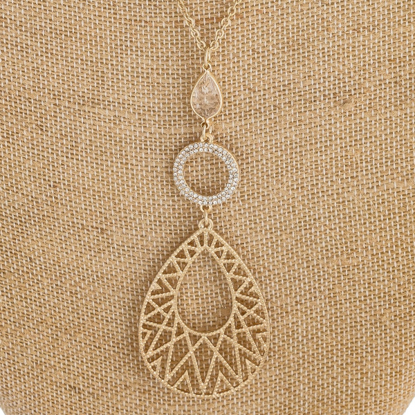 """Long cable chain necklace featuring a teardrop pendant with cubic zirconia and iridescent details. Pendant approximately 4"""". Approximately 38"""" in length overall."""