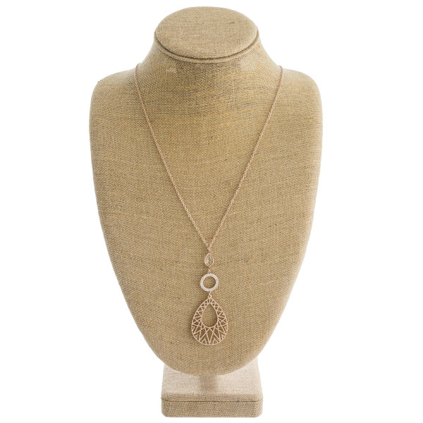 "Long cable chain necklace featuring a teardrop pendant with cubic zirconia and iridescent details. Pendant approximately 4"". Approximately 38"" in length overall."