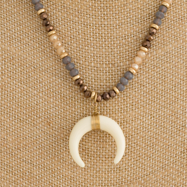 """Faceted beaded necklace featuring a crescent pendant with wire wrapped details and gold accents. Approximately 18"""" in length."""