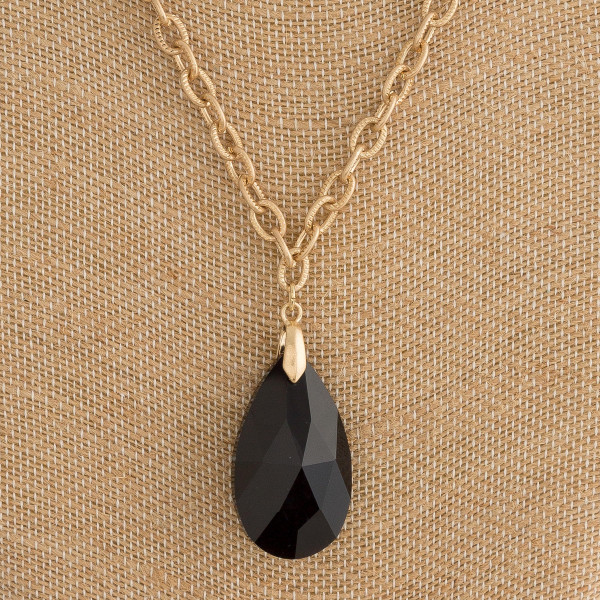 "Drawn cable chain necklace featuring a teardrop crystal pendant. Pendant approximately 1.5"". Approximately 20"" in length overall."