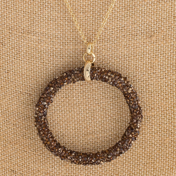 "Long rolo chain necklace featuring a rhinestone beaded pendant. Pendant approximately 2"". Approximately 36"" in length overall."