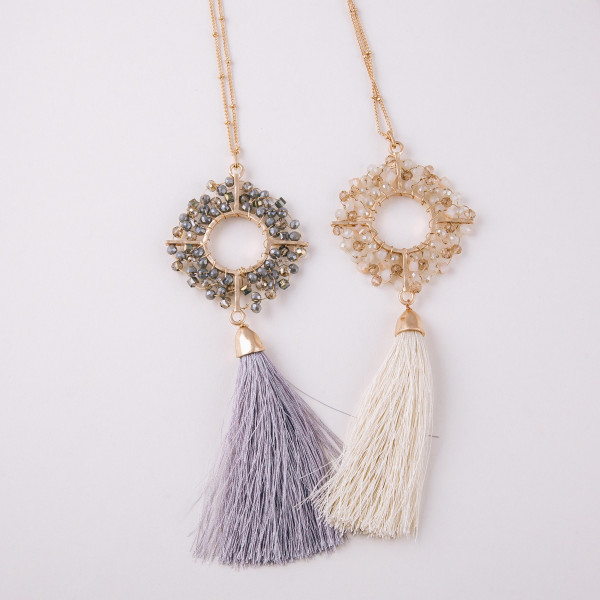 "Long satellite chain necklace featuring a beaded geometric tassel pendant. Pendant approximately 6"" length. Approximately 40"" in length overall."