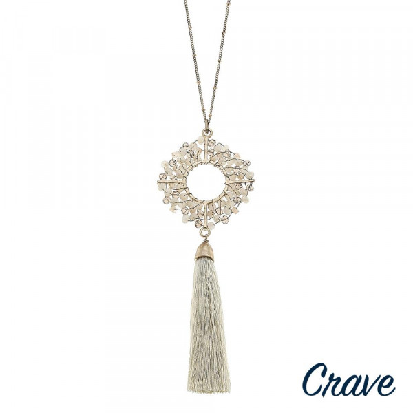 """Long satellite chain necklace featuring a beaded geometric tassel pendant. Pendant approximately 6"""" length. Approximately 40"""" in length overall."""