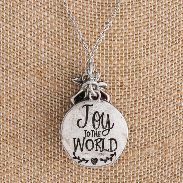 "Silver ""Joy to the World"" engraved Christmas charm necklace. Pendant approximately 1"" in diameter. Approximately 18"" in length overall."