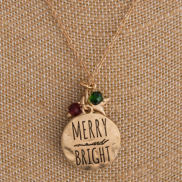 "Gold ""Merry Bright"" engraved Christmas charm necklace. Pendant approximately 1"" in diameter. Approximately 18"" in length overall."