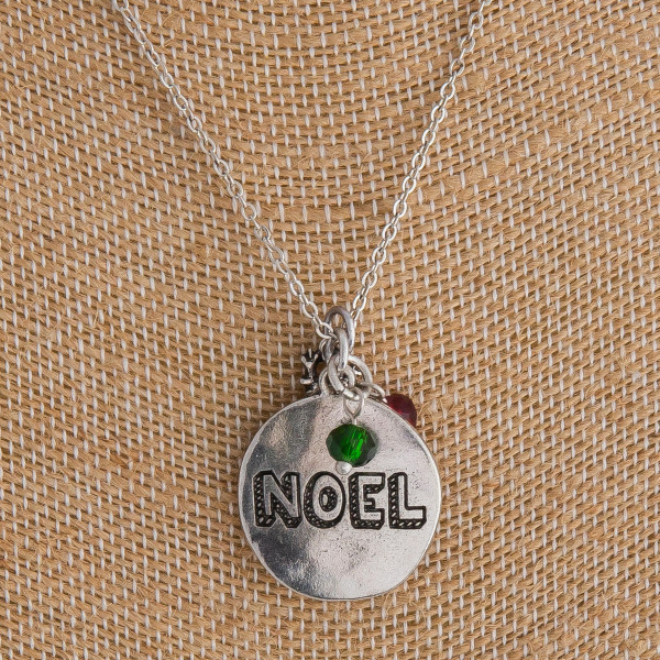 "Silver ""Noel"" engraved Christmas charm necklace. Pendant approximately 1"" in diameter. Approximately 18"" in length overall."