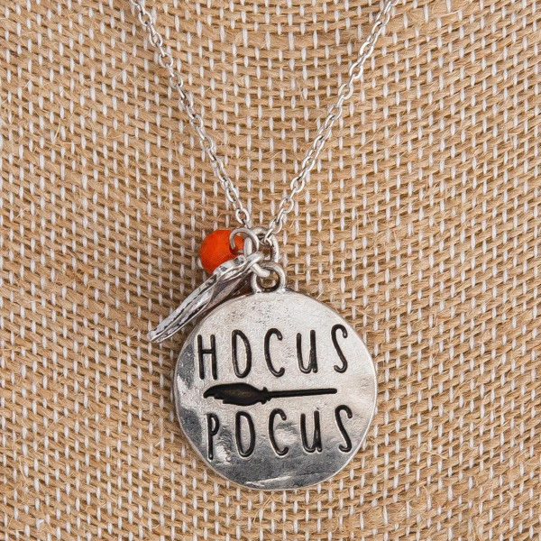 "Silver ""Hocus Pocus"" engraved halloween charm necklace. Pendant approximately 1"" in diameter. Approximately 18"" in length overall."