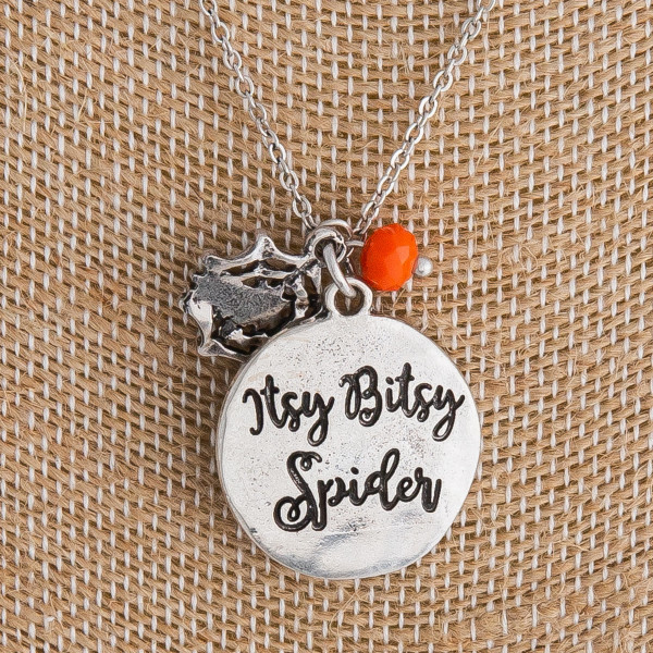 "Silver ""Itsy Bitsy Spider"" engraved halloween charm necklace. Pendant approximately 1"" in diameter. Approximately 18"" in length overall."