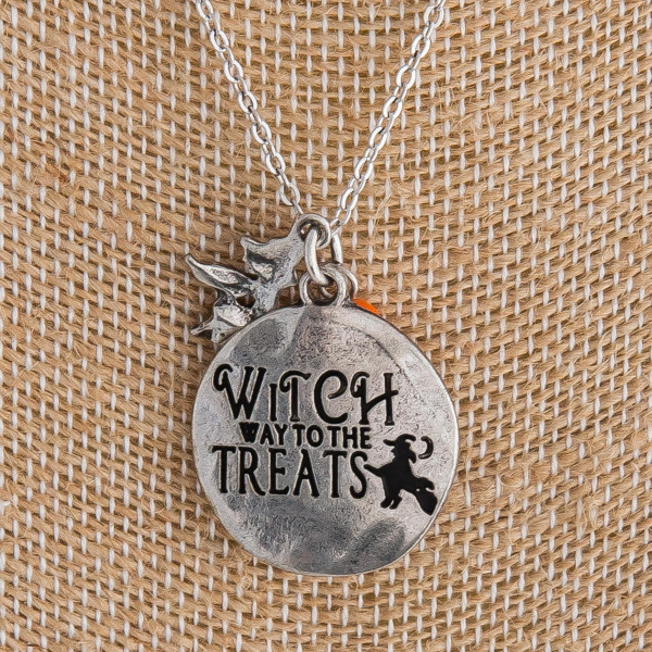 "Silver ""Witch way to the Treats"" engraved halloween charm necklace. Pendant approximately 1"" in diameter. Approximately 18"" in length overall."