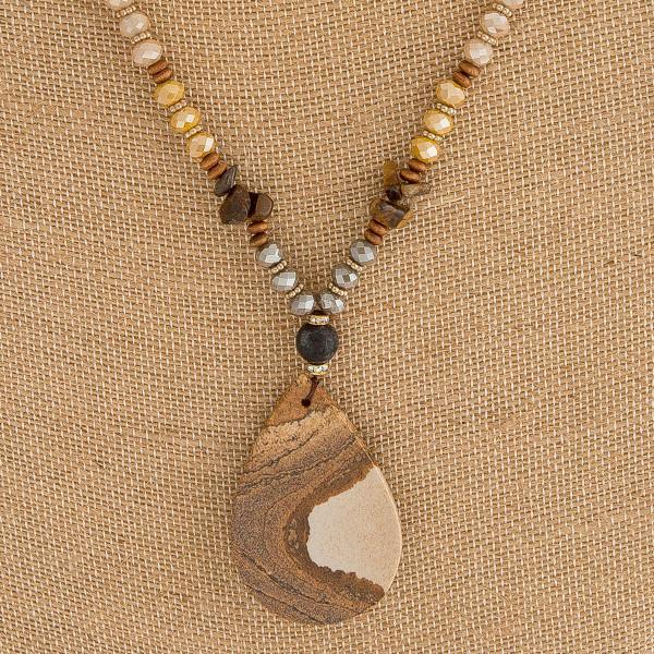 "Semi precious beaded necklace featuring a natural stone teardrop pendant. Pendant approximately 2"" in length. Approximately 32"" in length overall."