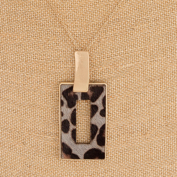 "Fur faux leather leopard print metal square encased pendant. Pendant approximately 3"" in length. Approximately 36"" in length overall."