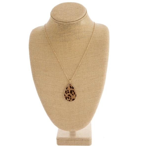 """Fur faux leather leopard print metal encased teardrop pendant necklace. Pendant approximately 2"""" in length. Approximately 36"""" in length overall."""