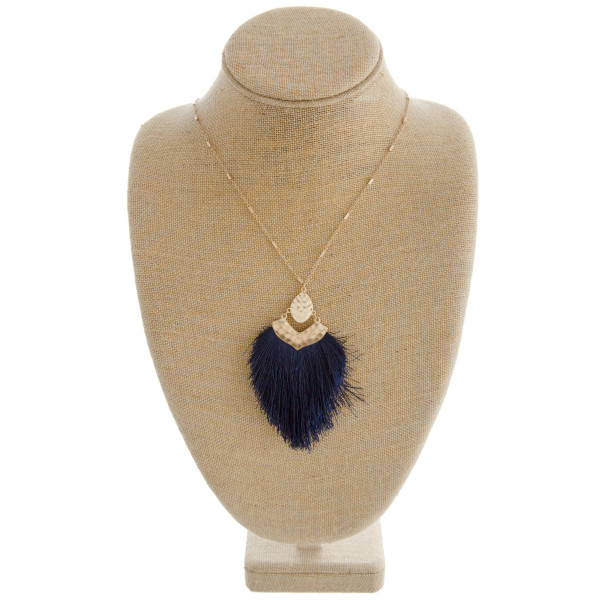 "Link bar necklace featuring a tassel pendant with hammered metal accents. Pendant approximately 4"" in length. Approximately 38"" in length overall."