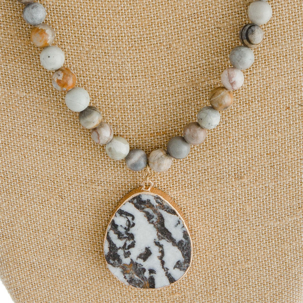"""Semi precious beaded natural stone pendant necklace. Pendant approximately 2.5"""" in length. Approximately 32"""" in length overall."""