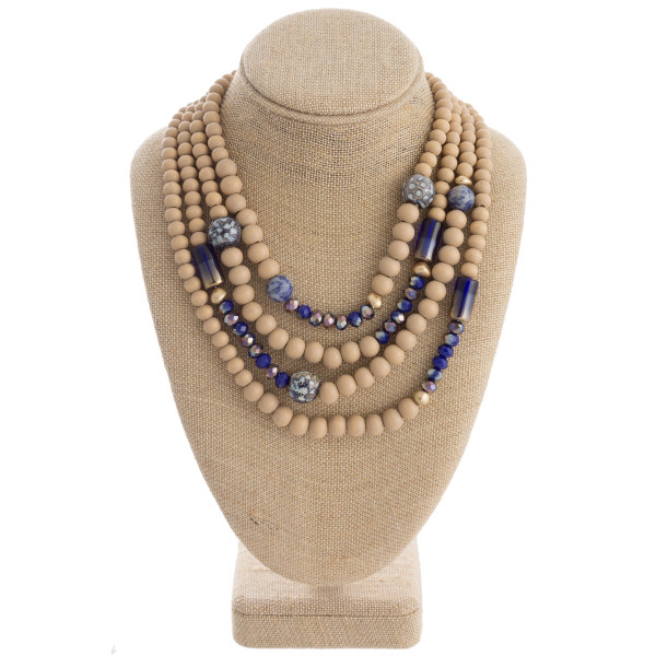 """Wood beaded layered statement necklace with glass bead details. Approximately 18"""" in length."""