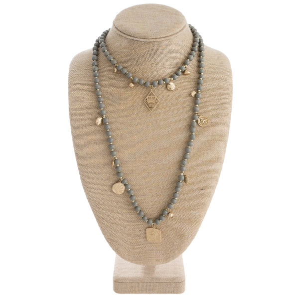 """Wood beaded layered necklace with gold metal accents. Approximately 28"""" in length."""