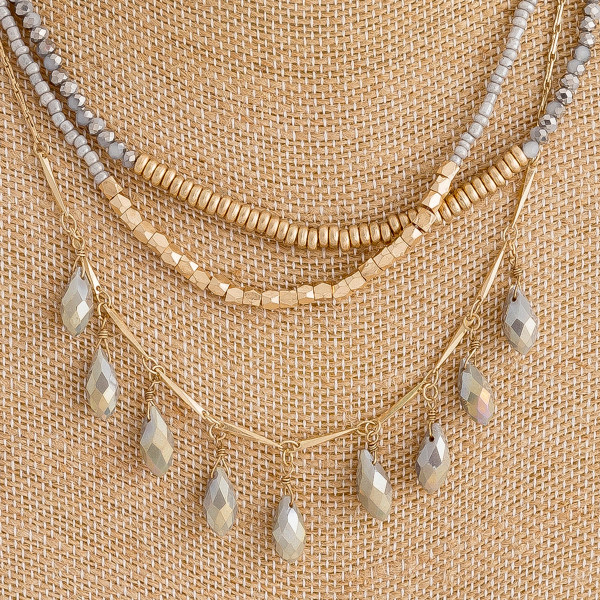 "Layered beaded teardrop chandelier boho necklace with metal accents. Approximately 16"" in length."
