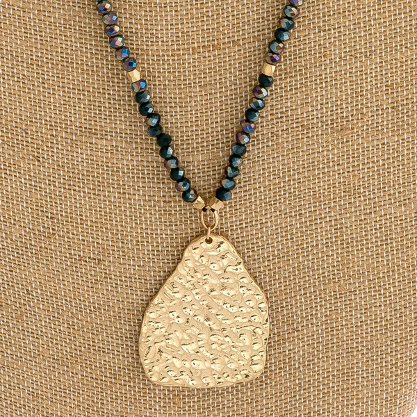 """Long beaded necklace with hammered nugget pendant.   - Pendant approximately 2"""" in length  - Approximately 28"""" in length overall"""