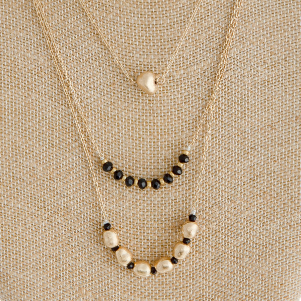 "Cable chain layered necklace featuring metal and faceted beaded details. Approximately 18"" in length."