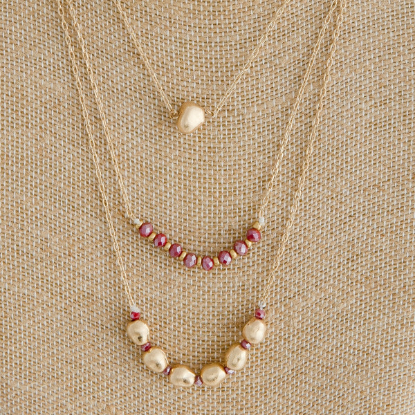 """Cable chain layered necklace featuring metal and faceted beaded details. Approximately 18"""" in length."""