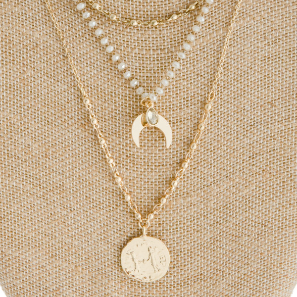 """Layered beaded crescent coin necklace. Approximately 20"""" in length."""
