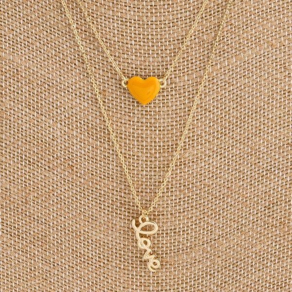 "Dainty layered enamel coated ""Love"" script necklace. Approximately 18"" in length."