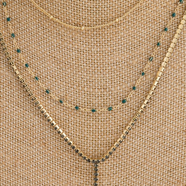"Metal layered rhinestone Y necklace featuring enamel coated accents. Shortest approximately 12"" in length and  24"" in length overall."