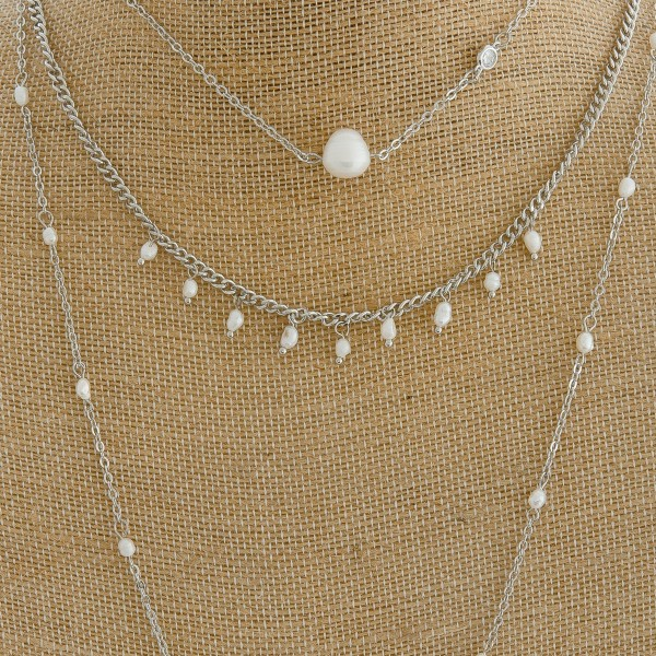 "Long layered pearl beaded necklace.   - Shortest layer approximately 12"" in length - Approximately 32"" in length overall with 3"" extender"