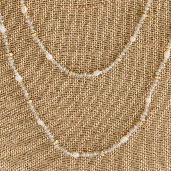 "Long double layered pearl beaded necklace. Approximately 30"" in length."