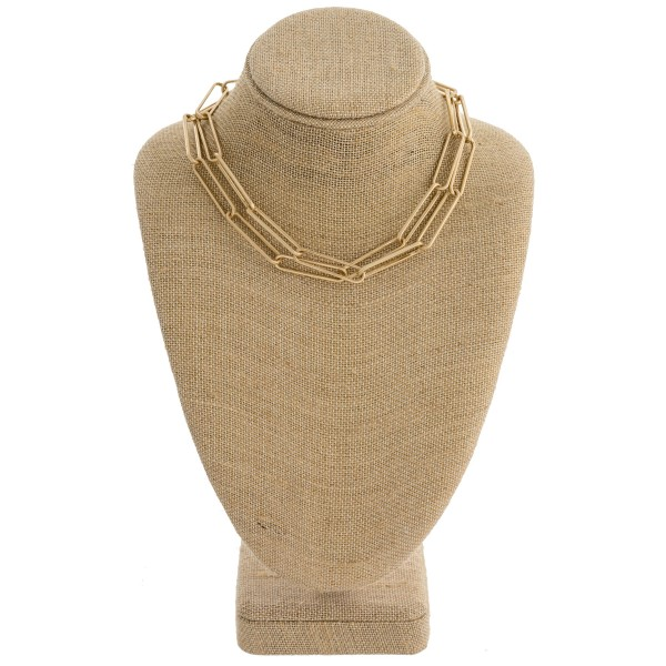 "Layered chain linked collar necklace. Approximately 12"" in length with 2.5"" extender."