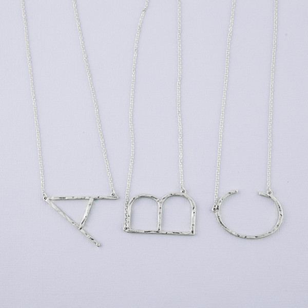 """Hammered initial """"B"""" necklace. Pendant approximately 1.75"""" in length. Approximately 18"""" in length overall."""