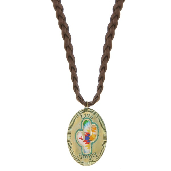 """Brown faux leather braided necklace featuring a patina tone cactus pendant with """"Live Simply"""" engraved details.  - Pendant approximately 2.75"""" in length - Approximately 38"""" in length overall with a 3.5"""" extender"""