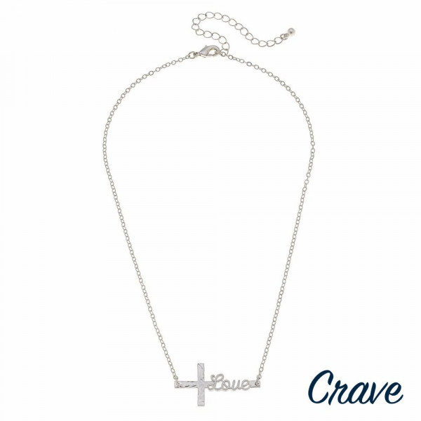 "Silver cable chain east west cross ""Love"" script necklace. Pendant approximately 1.5"" in length. Approximately 16"" in length overall."