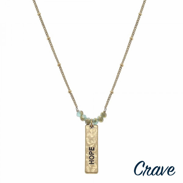 "Gold satellite chain hammered ""Hope"" engraved bar pendant necklace featuring beaded accents. Pendant approximately 1"" in length. Approximately 16"" in length overall."