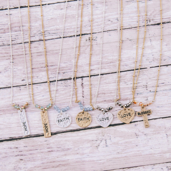 """Gold satellite chain hammered """"Hope"""" engraved bar pendant necklace featuring beaded accents. Pendant approximately 1"""" in length. Approximately 16"""" in length overall."""