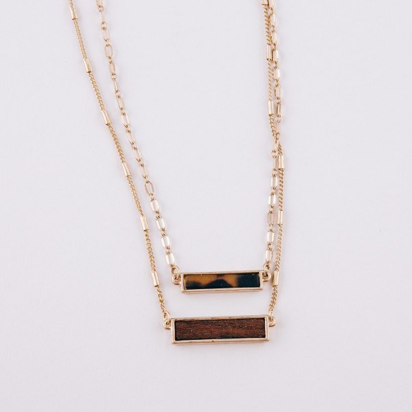 """Layered resin and wood bar necklace. Pendant's approximately 1"""" in length. Approximately 16"""" in length overall."""