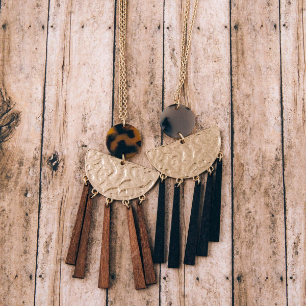"""Long hammered half moon resin accented wooden tassel necklace. Pendant approximately 3.5"""" in length. Approximately 36"""" in length overall."""